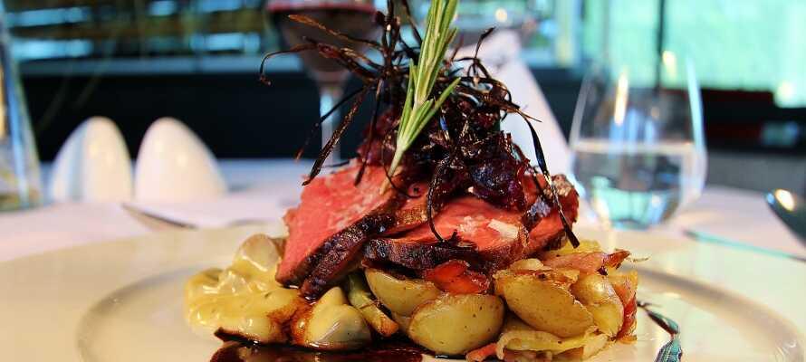 Få noe godt å spise i restauranten og prøv de gode retter som serveres i hyggelige omgivelser.